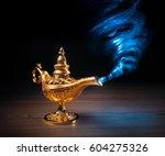 magic genie lamp with smoke on... | Shutterstock . vector #604275326