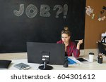 the girl is sitting and working ... | Shutterstock . vector #604301612