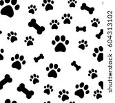 paw print seamless. traces of... | Shutterstock . vector #604313102