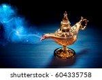 magic genie lamp with smoke on... | Shutterstock . vector #604335758
