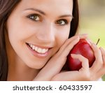 Smiling Young Woman With Red...
