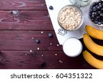 oatmeal flakes with blueberry... | Shutterstock . vector #604351322