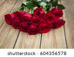 Stock photo bouquet red roses on a wooden background 604356578