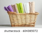 soft terry towels in a basket... | Shutterstock . vector #604385072
