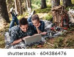 a couple of tourists lie on the ... | Shutterstock . vector #604386476