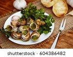 escargots de bourgogne   snails ... | Shutterstock . vector #604386482