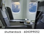 flying by business class... | Shutterstock . vector #604399052