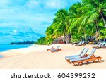 beach chairs on the white sand...   Shutterstock . vector #604399292