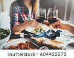 young happy couple cheering... | Shutterstock . vector #604422272