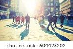 silhouette of people walking on ... | Shutterstock . vector #604423202