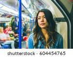 asian woman on the tube in... | Shutterstock . vector #604454765