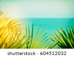 frame of tropical green palm... | Shutterstock . vector #604512032