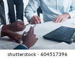 Small photo of Business negotiations or meeting, preparing documents for signing. Interracial partnership.