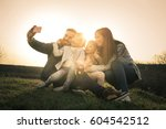 happy family smiling while... | Shutterstock . vector #604542512