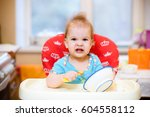 kid plays in the kitchen with... | Shutterstock . vector #604558112