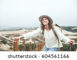 cheerful traveling woman with... | Shutterstock . vector #604561166
