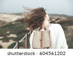 adventure woman with waving... | Shutterstock . vector #604561202