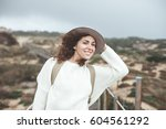 smiling woman with curly brown... | Shutterstock . vector #604561292