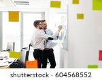 two businessmen working at... | Shutterstock . vector #604568552
