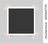 photo frame with sticky tape on ... | Shutterstock .eps vector #604569755