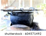 black pot and firewood for...   Shutterstock . vector #604571492