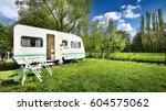 caravan trailer on a green lawn ... | Shutterstock . vector #604575062