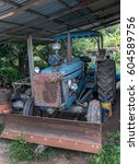 dirty old tractor parked under... | Shutterstock . vector #604589756