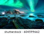 aurora borealis above snowy... | Shutterstock . vector #604599662