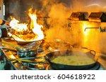 chef in restaurant kitchen at... | Shutterstock . vector #604618922