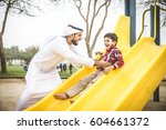 arabic family playing with child | Shutterstock . vector #604661372