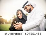 arabic couple with traditional... | Shutterstock . vector #604661456