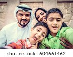 arabic family playing with child | Shutterstock . vector #604661462