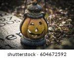 Scary Pumpkin At A Graveyard