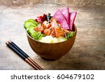 hawaiian salmon poke bowl with... | Shutterstock . vector #604679102