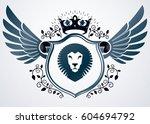 vector retro insignia design... | Shutterstock .eps vector #604694792
