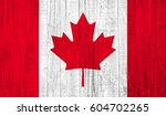 canada flag on wood texture... | Shutterstock . vector #604702265