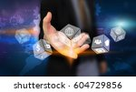 businessman holding glowing... | Shutterstock . vector #604729856