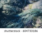 pile of commercial fishing nets | Shutterstock . vector #604733186