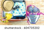 open the suitcase with tourist... | Shutterstock . vector #604735202