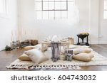 an apartment with a table set... | Shutterstock . vector #604743032