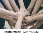 unity teamwork business and... | Shutterstock . vector #604743932