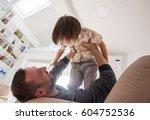 cheerful young boy having fun... | Shutterstock . vector #604752536