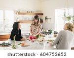 three women talking and...   Shutterstock . vector #604753652