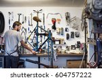 a man working in a bicycle... | Shutterstock . vector #604757222