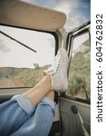 feet on the dashboard of a jeep  | Shutterstock . vector #604762832