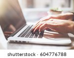 male hands using laptop in... | Shutterstock . vector #604776788