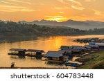houseboat village in mon bridge ... | Shutterstock . vector #604783448