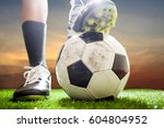 soccer shoes   football on the... | Shutterstock . vector #604804952
