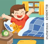 a little girl wake up in the... | Shutterstock .eps vector #604809758