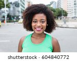 cute young woman from africa in ... | Shutterstock . vector #604840772